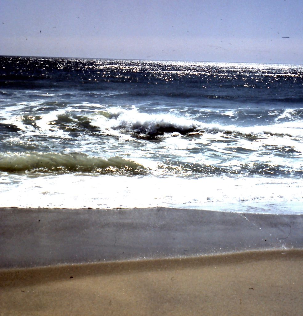 image of wave receding at beach