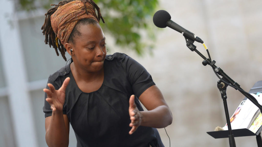 Photo of author Bibish Marie-Louise Mumbu at a microphone