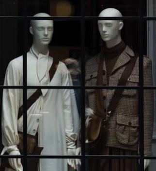Two mannequins behind a store window